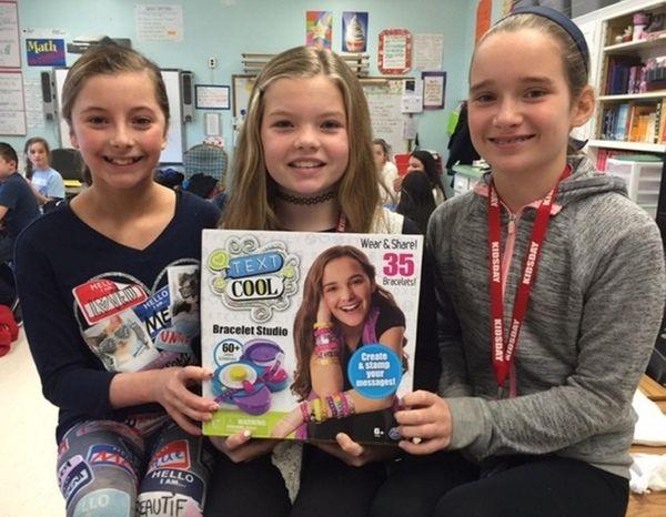 Kidsday reporters Ava Sidik, left, Madison Williams and