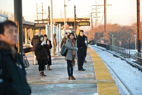 Passengers wait for a delayed Manhattan-bound train at