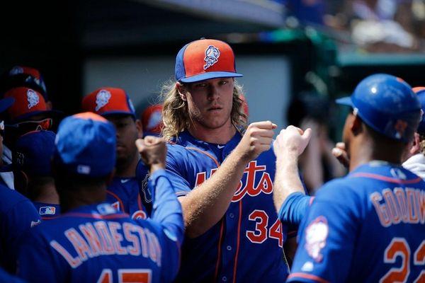 New York Mets starting pitcher Noah Syndergaard, center,