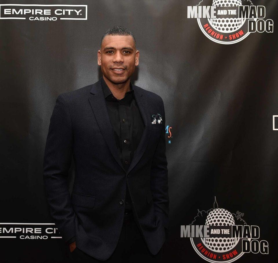 Former New York Knicks' Allan Houston walks the