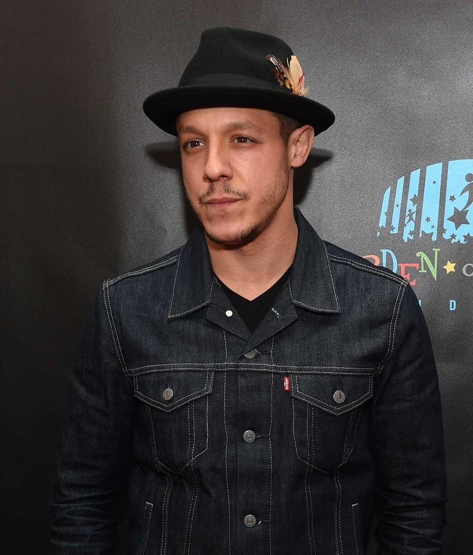 Actor Theo Rossi walks the red carpet before