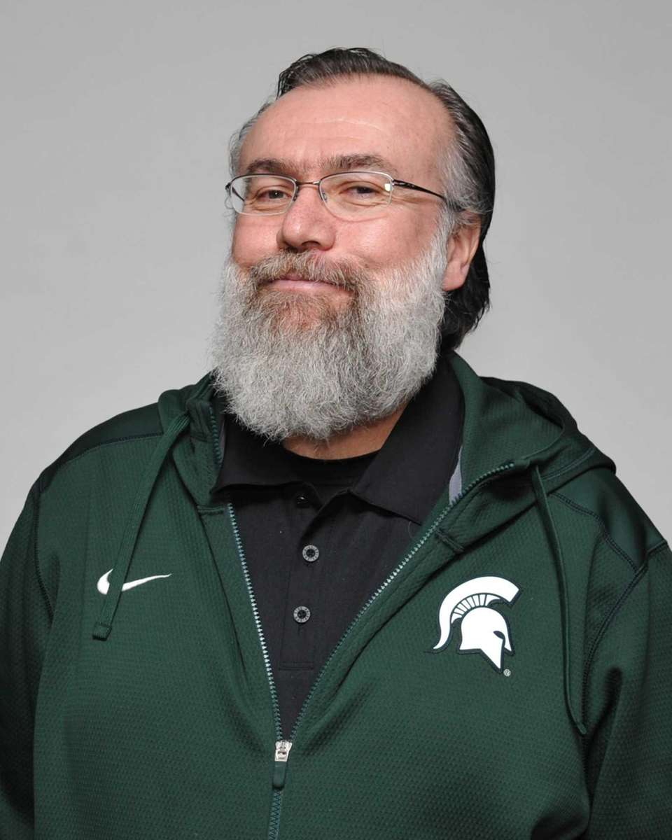 Coach George Holub of Elmont.