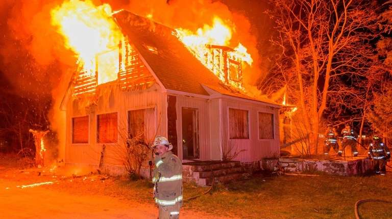 Firefighters at the scene of a house fire