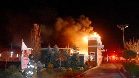 Firefighters battle a blaze at a McDonald's restaurant