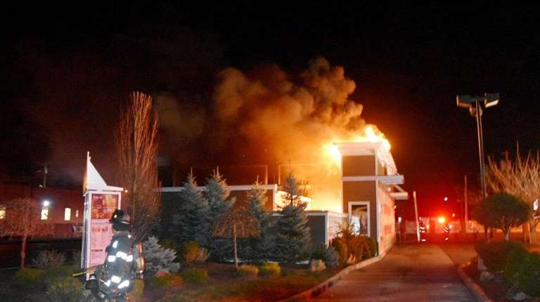 Firefighters battle a blaze at a McDonald's restaurant