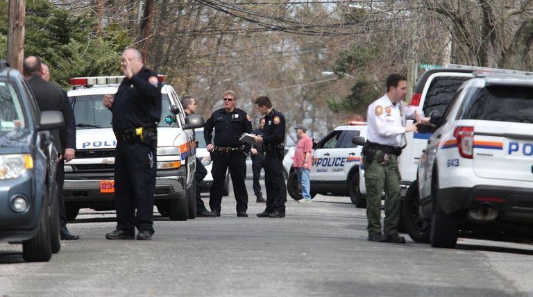 Nassau Police investigate scene on Walnut Street on