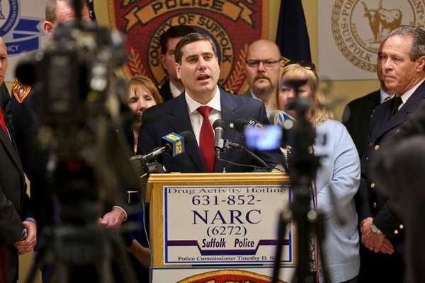 Suffolk County Police Commissioner Timothy Sini, center, is