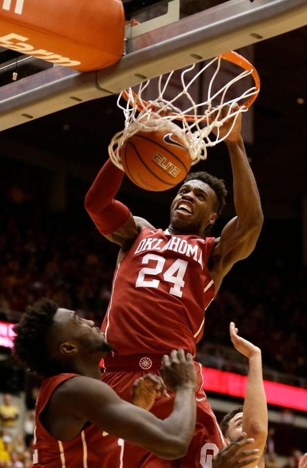 Oklahoma guard Buddy Hield dunks the ball during