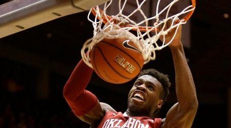 Oklahoma guard Buddy Hield dunks the ball during