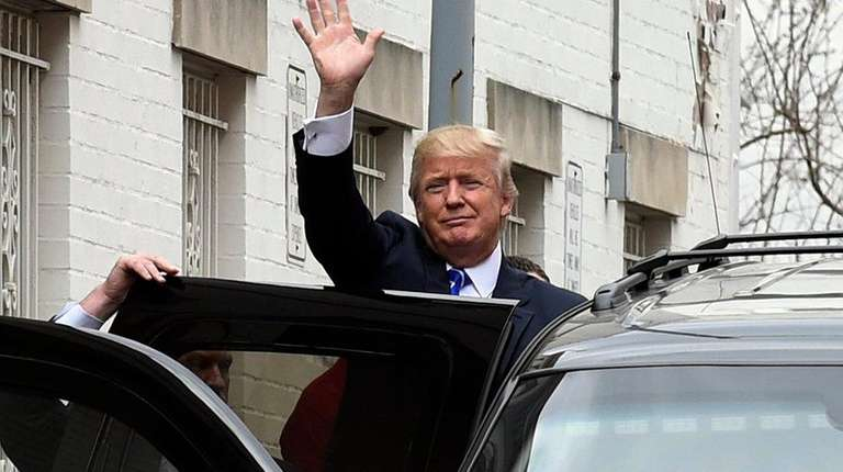 Republican presidential candidate Donald Trump waves as