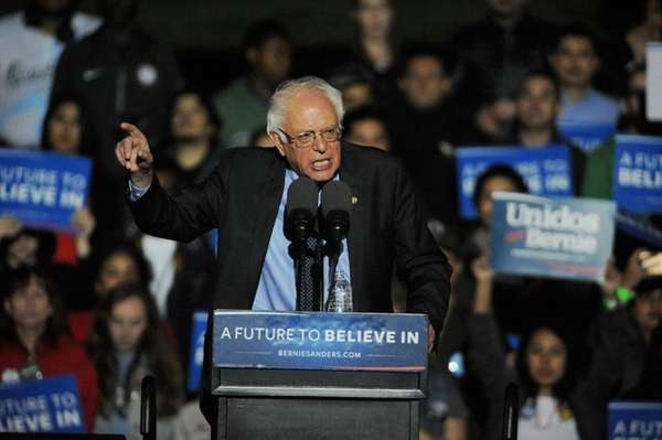Presidential candidate Bernie Sanders tells a packed rally