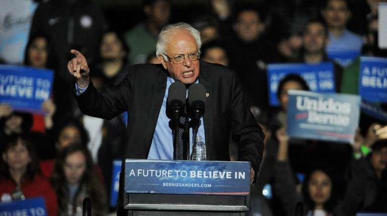 Presidential candidate Bernie Sanders tells a packed rally