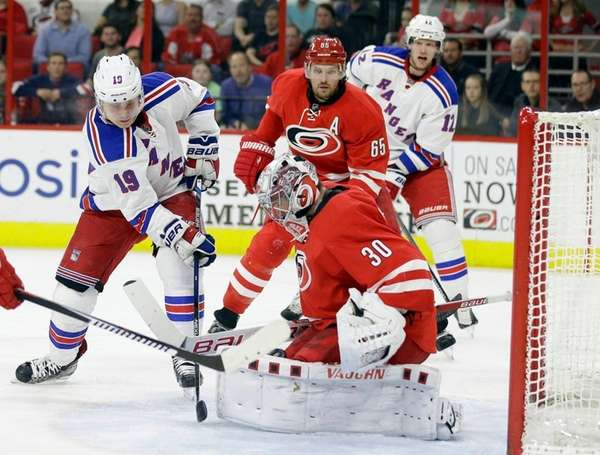 Carolina Hurricanes goalie Cam Ward defends the goal
