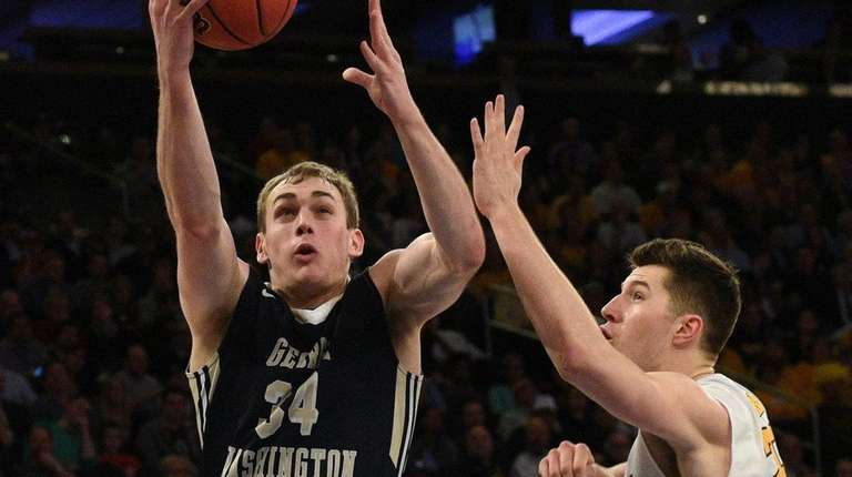 George Washington Colonials forward Tyler Cavanaugh puts up