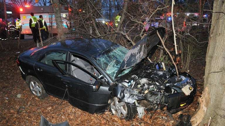 Police and firefighters respond after a Mazda sedan