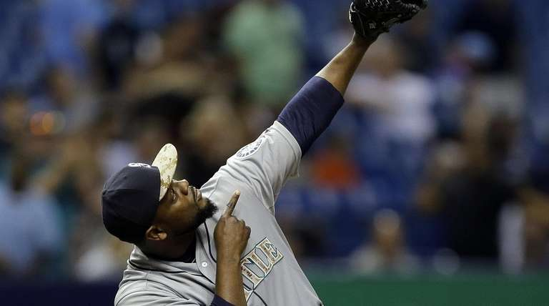 Seattle Mariners relief pitcher Fernando Rodney points after