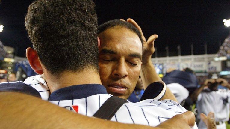 Mariano Rivera hugs Yankees teammate Jorge Posada after