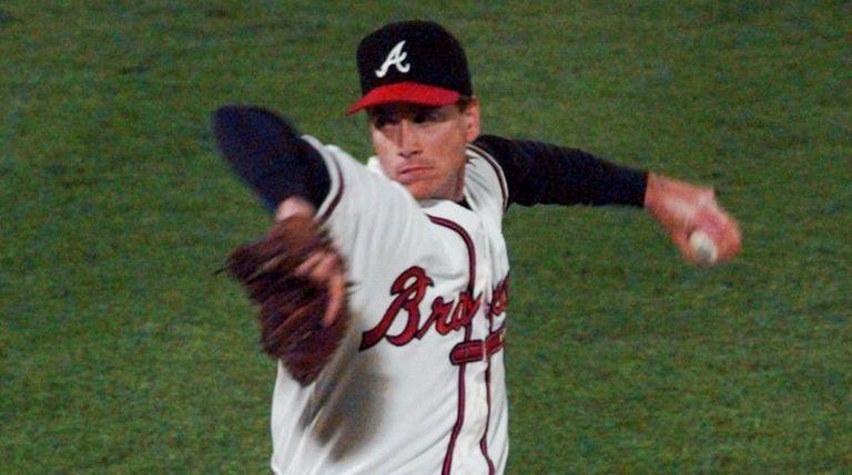 Atlanta Braves starting pitcher Tom Glavine fires one