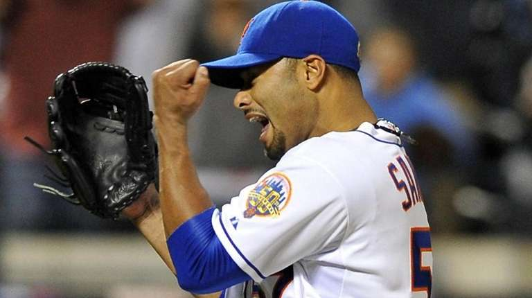 Johan Santana celebrates recording the final out of