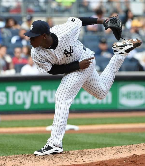New York Yankees starting pitcher Luis Severino delivers