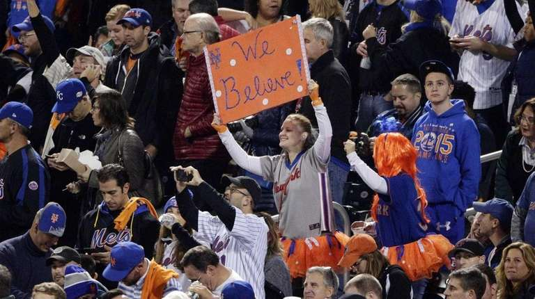 Fans cheer during the sixth inning of Game