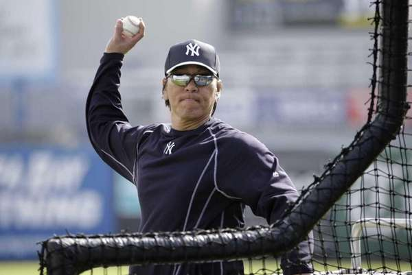 Hideki Matsui throws batting practice at the