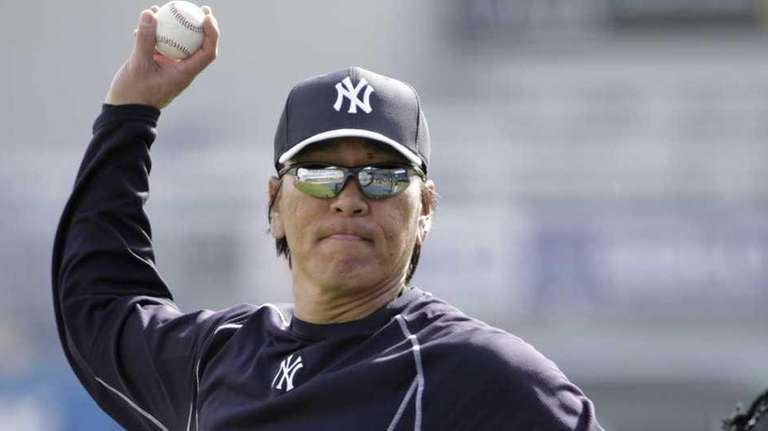 Hideki Matsui throws batting practice at the