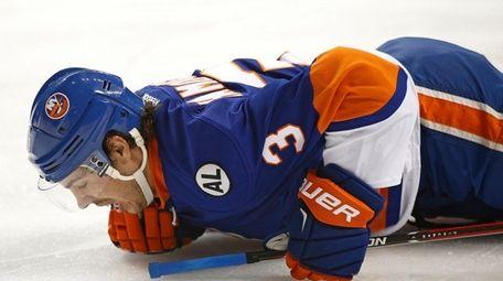 New York Islanders defenseman Travis Hamonic lies on