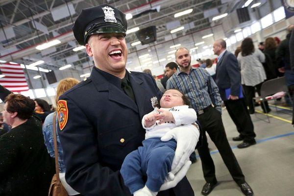 Police Officer Francis Guzman of Lindenhurst holds his