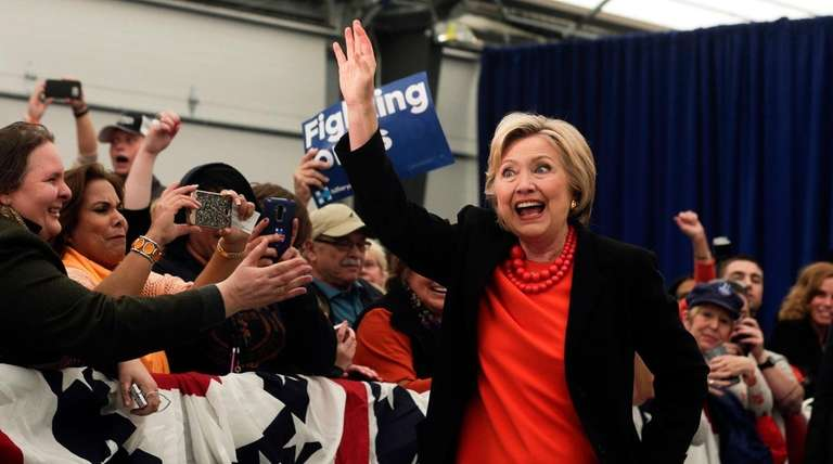 Democratic presidential candidate Hillary Clinton waves as she