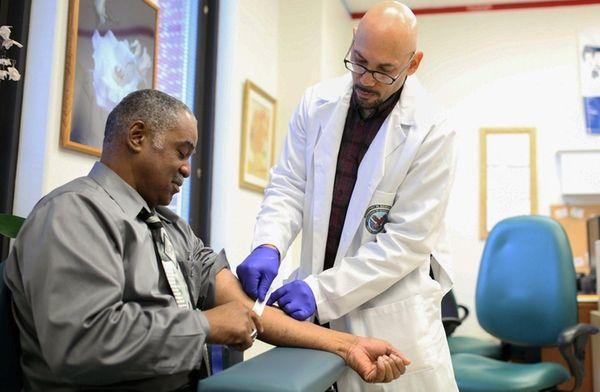 Donald Brooks, left, has a blood sample taken