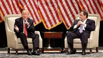 Republican presidential candidate Donald Trump, left, talks with