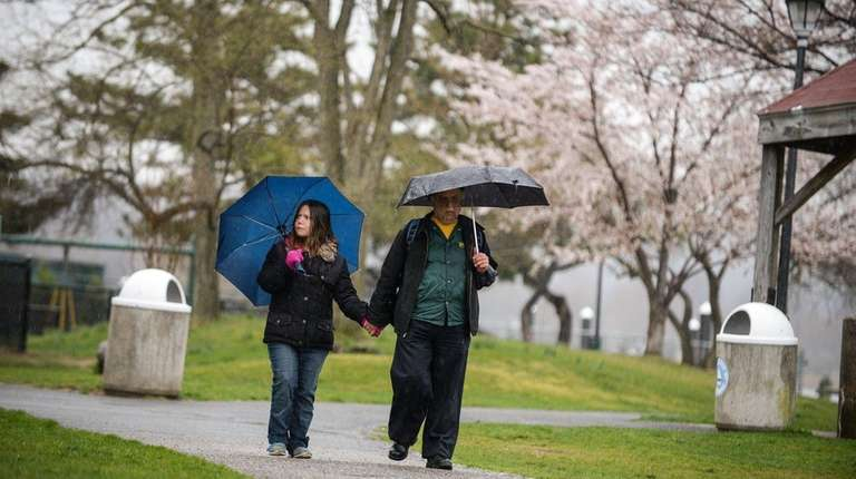 Fred Madjidi, of East Northport, walks with his