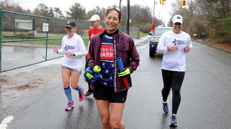 Eva Casale, front, runs along Ridge Road in
