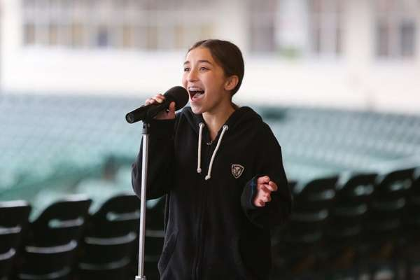 Lauren Nilsen of Bellmore, 13, sings the