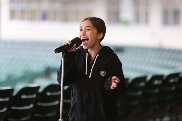 Lauren Nilsen of Bellmore, 13, sings the