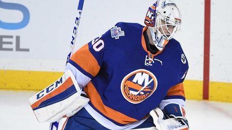 New York Islanders goalie Jean-Francois Berube skates back