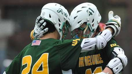 Andrew Lockhart #41 of Ward Melville, right, gets