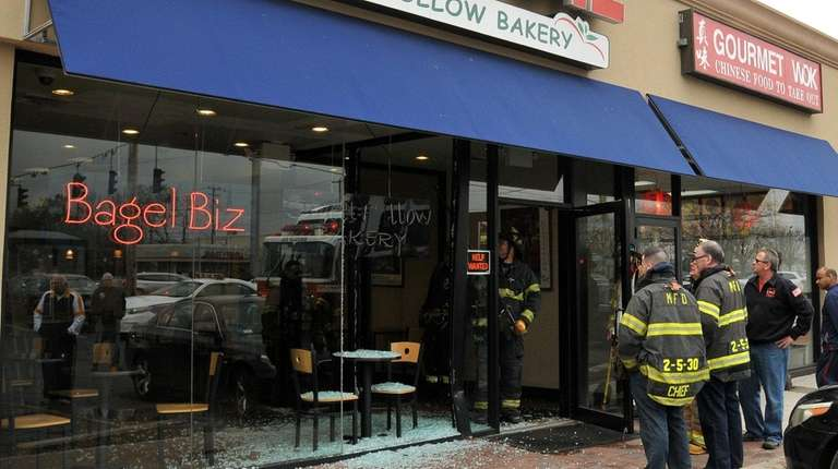 A BMW crashed into a Melville bagel shop