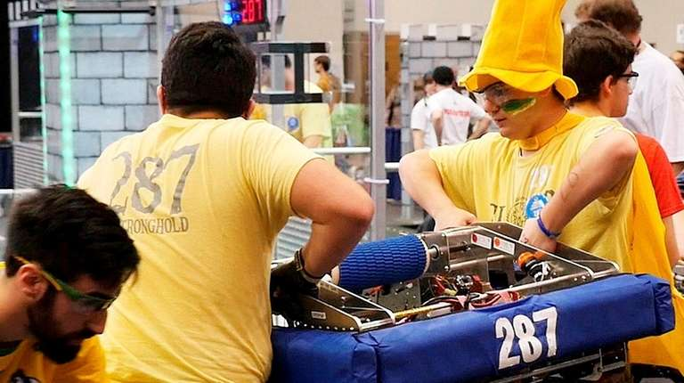 William Floyd High School robotics team members carry