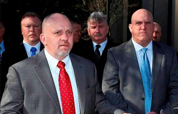 Suffolk County PBA President Noel DiGerolamo, left, seen