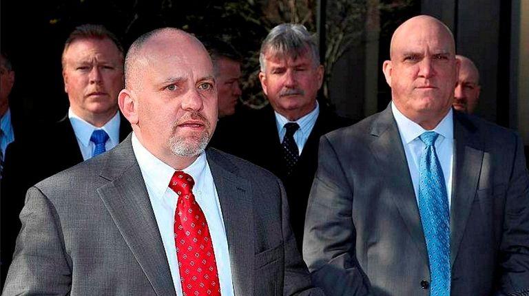 Suffolk County PBA President Noel DiGerolamo, left, seen