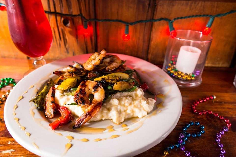 Tupelo honey shrimp and grits is served at