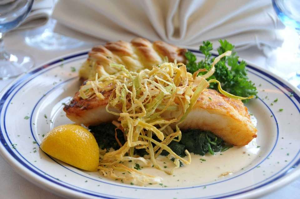 Pan-seared Chilean sea bass with spinach and stuffed