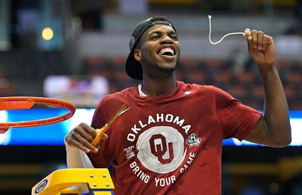 Oklahoma guard Buddy Hield cuts down the