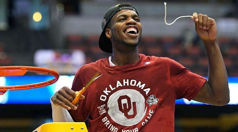Oklahoma guard Buddy Hield cuts down the