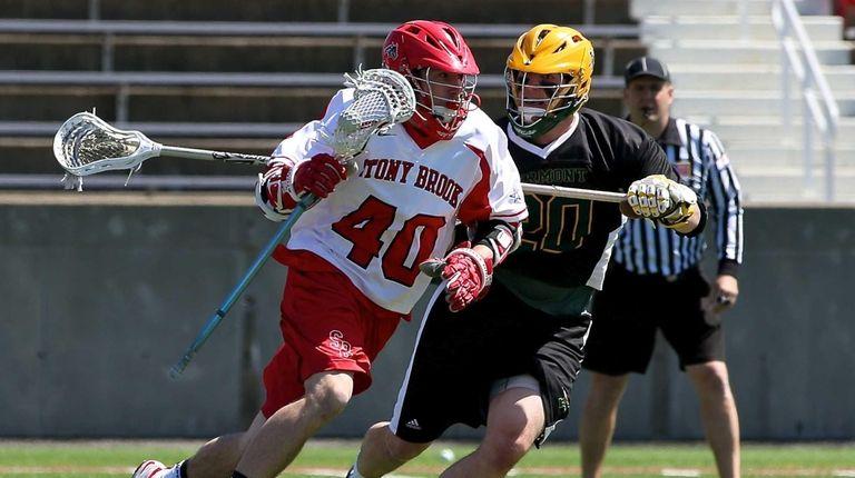Stony Brook's Matt Schultz moves around the net