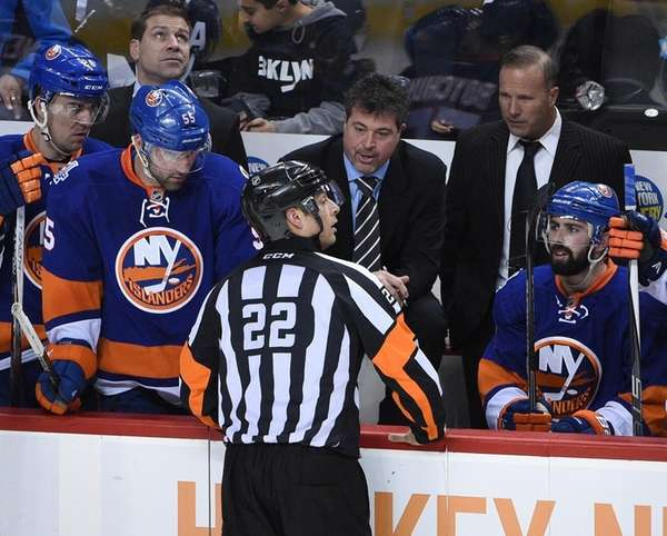 New York Islanders coach Jack Capuano talks to