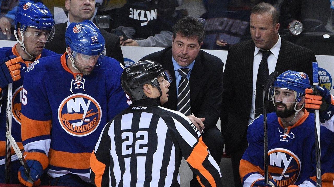 New York Islanders coach Jack Capuano talks to