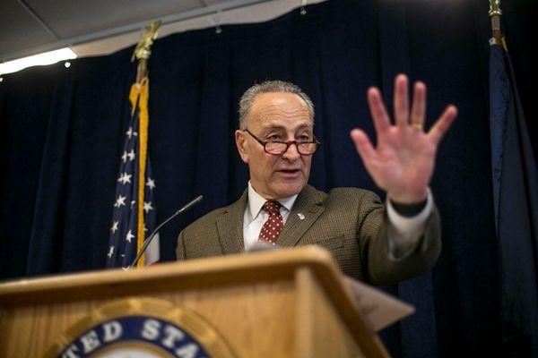 U.S. Senator Chuck Schumer gestures at a news